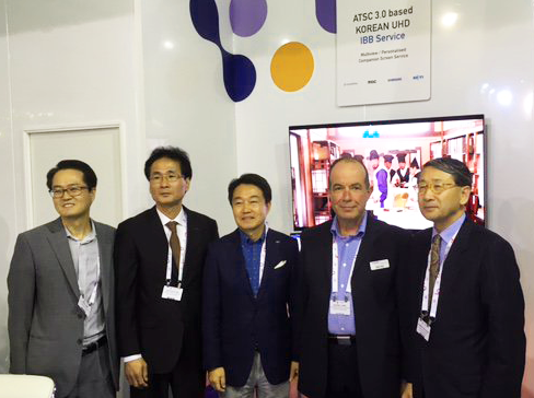 Korean Ambassador with Eurofins Digital Testing's Marketing Manager, Peter Cope.