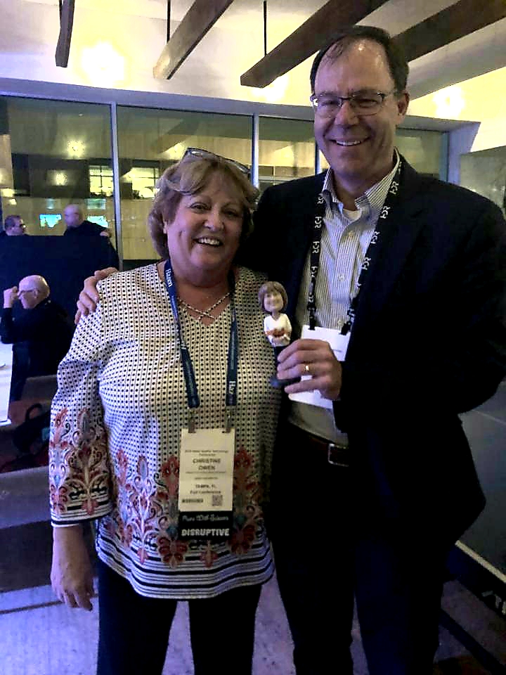 Christine Owen and Bobblehead winner Bill Becker